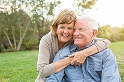 older couple smiling outside
