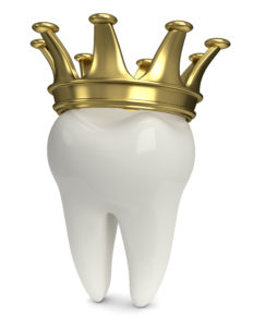 white tooth golden crown on top
