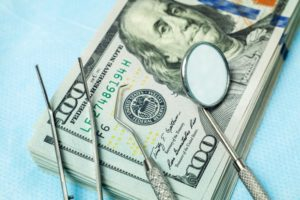 Tools for dental implants in Plano on 100 dollar bills