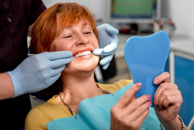 Woman smiling with dental implants in Plano